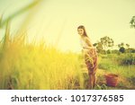 thai beautiful girl hold wicker ... | Shutterstock . vector #1017376585