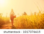 thai beautiful girl hold wicker ... | Shutterstock . vector #1017376615
