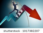 businessman jumping over tax in ...   Shutterstock . vector #1017382207