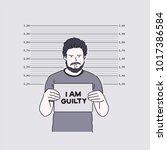 a criminal who takes a mug shot.... | Shutterstock .eps vector #1017386584