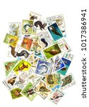 a collage of postage stamps on... | Shutterstock . vector #1017386941