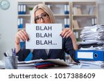 Small photo of Businesswoman with message in office at desk
