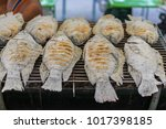 barbecued fish at a local thai...   Shutterstock . vector #1017398185