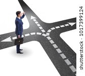 young businessman at crossroads ... | Shutterstock . vector #1017399124
