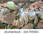 View of the air balloon flying over rock formation in Cappadocia,Turkey - stock photo
