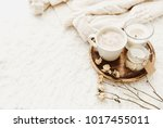 coffee cup with candles in cozy ... | Shutterstock . vector #1017455011