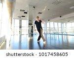 male dancer making warm up... | Shutterstock . vector #1017458605
