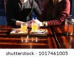 lovers order hot sea buckthorn... | Shutterstock . vector #1017461005