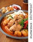 delicious spicy chicken stew in ...   Shutterstock . vector #1017464167