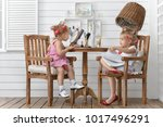two little girls play in the... | Shutterstock . vector #1017496291