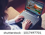 woman using a laptop to edit... | Shutterstock . vector #1017497701
