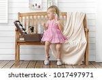 little girl play in the beauty...   Shutterstock . vector #1017497971