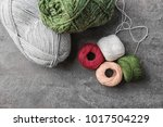 colorful threads on grey... | Shutterstock . vector #1017504229
