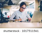 concentrated woman in eyewear... | Shutterstock . vector #1017511561