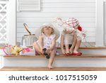 two little girls play in the...   Shutterstock . vector #1017515059