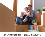 couple moving in house sitting... | Shutterstock . vector #1017522349