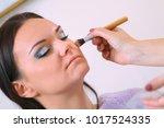 make up artist applying... | Shutterstock . vector #1017524335