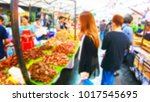 blurred people shopping at... | Shutterstock . vector #1017545695