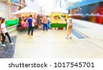 blurred people shopping at... | Shutterstock . vector #1017545701