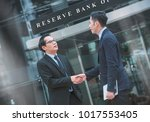 two businessman to contract... | Shutterstock . vector #1017553405