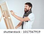 joyful painter draws on canvas ... | Shutterstock . vector #1017567919
