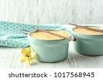 ramekins with tasty vanilla... | Shutterstock . vector #1017568945