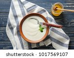 tasty yogurt in dish and jar of ... | Shutterstock . vector #1017569107