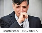 crying colombian business man... | Shutterstock . vector #1017580777