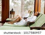 pretty young women relaxing on... | Shutterstock . vector #1017580957