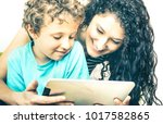 young mother having fun with... | Shutterstock . vector #1017582865