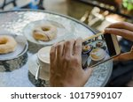 closeup hands taking photo... | Shutterstock . vector #1017590107