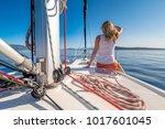 woman enjoying a day on a yacht ... | Shutterstock . vector #1017601045