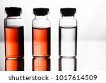 ampoules with red liquid. on... | Shutterstock . vector #1017614509