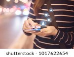 woman hands using mobile... | Shutterstock . vector #1017622654