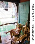 Small photo of girl sits in a bookstore on the water of Alta Acqua Libreria in Venice, Italy.