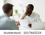 serious attentive african hr... | Shutterstock . vector #1017665224