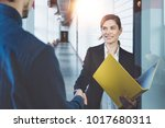 two business people shaking... | Shutterstock . vector #1017680311