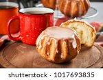 delicious sweet rum baba cake...   Shutterstock . vector #1017693835
