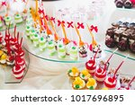 delicious sweets on wedding... | Shutterstock . vector #1017696895
