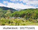 a spring mountain village  the... | Shutterstock . vector #1017711631