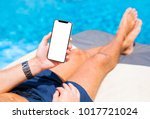 man using mobile phone on... | Shutterstock . vector #1017721024