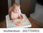 little cute girl sitting in...   Shutterstock . vector #1017733921