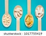 healthy supplements on wooden... | Shutterstock . vector #1017755419