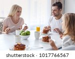 beautiful happy family eating... | Shutterstock . vector #1017766567