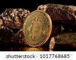 golden bitcoin and gold lumps... | Shutterstock . vector #1017768685