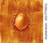 realistic golden egg on hand... | Shutterstock .eps vector #1017770011