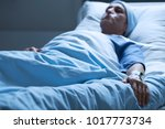 dying woman in pain despite... | Shutterstock . vector #1017773734