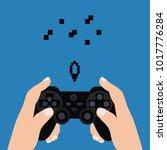 hands holding joy pad vector.... | Shutterstock .eps vector #1017776284