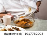 person accidently spilled curry ... | Shutterstock . vector #1017782005