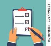 checklist clipboard. human... | Shutterstock .eps vector #1017798835